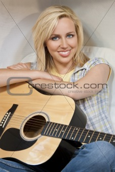 Beautiful Young Woman Playing A Guitar