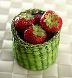 Strawberries in a green little basket