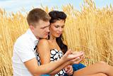 Couple looking at a wheat ear