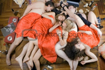 Sleeping young people after a party