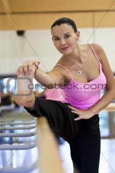 Woman Stretching Before Dancing