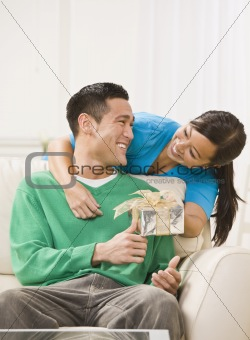 Attractive Couple Exchanging Gifts