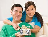 Couple Holding Present