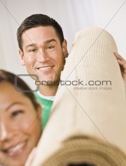 Attractive Couple with Roll of Carpet