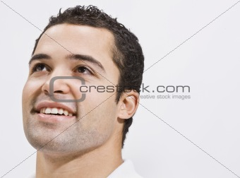 Attractive Man Looking Up and Smiling