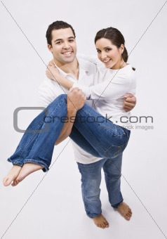 Attractive Man Holding Beautiful Woman