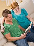 Attractive Couple Reading Together