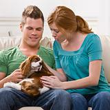 Young Couple Holding Dog