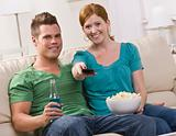 Attractive couple watching TV