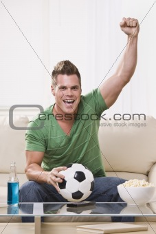 Soccer Fan Pumping His Fist While Watching the Game