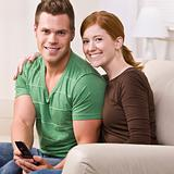 Attractive Couple Smiling with Cellphone