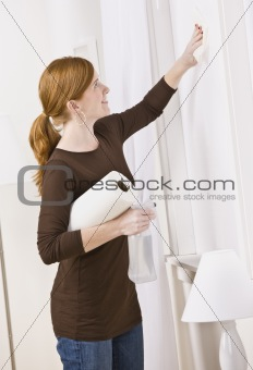Attractive woman cleaning