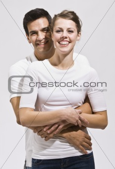 Attractive Couple Hugging and Smiling