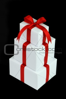 three white gift boxes with red ribbon