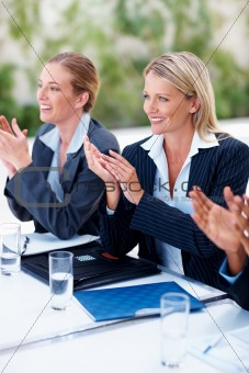 Business woman applauding on an achievement at work