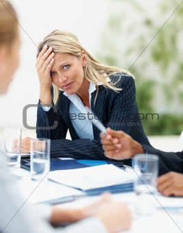 Upset young business woman at a meeting
