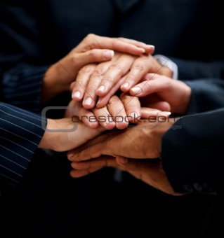 Group of hands on top of each other over