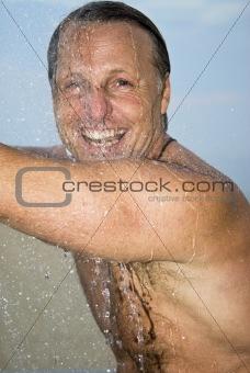 man under shower.