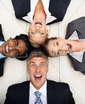 Successful business team lying on the floor