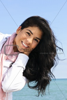 Beautiful young woman at beach