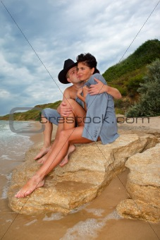 Couple sitting on a rock