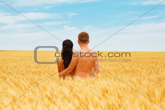 Couple standing in a wheat field