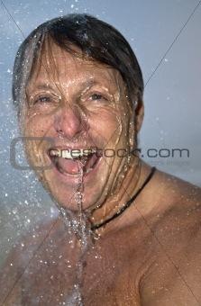 man under shower