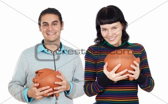 Attractive teenagers with money box