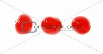 three cherry red fruits macro on white
