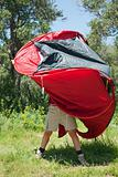 woman pitching tent