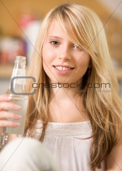 lovely teenage girl with bottle of water