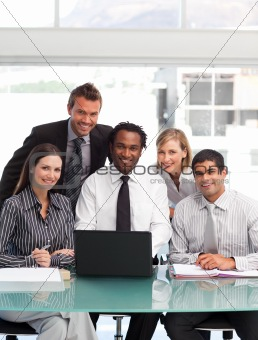 Business team working together smiling at the camera