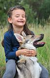 little girl and her baby wolf dog