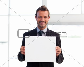 Smiling businessman holding a white card