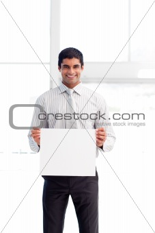 Hispanic businessman holding a white card