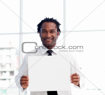 Portrait of an Afro-American businessman holding a white card