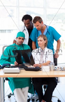 Group of doctors studying an X-ray