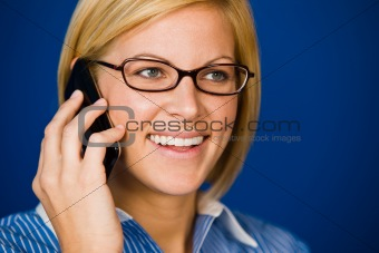 Happy, pretty young woman using cell phone