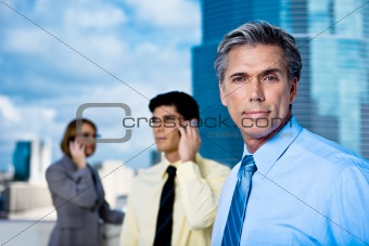 Mature Businessman and His Team