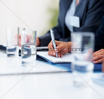 Closeup of a business man making a note