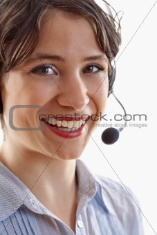 business - young brunette woman with headset on her head