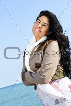 Beautiful young woman at beach
