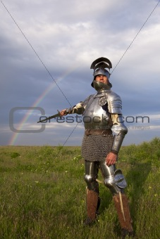 medieval knight in the field, and a rainbow