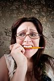 Nervous Woman Chewing on a Pencil
