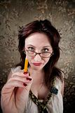 Curious woman pointing with pencil