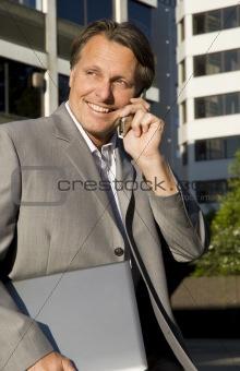 Businessman on cellphone.