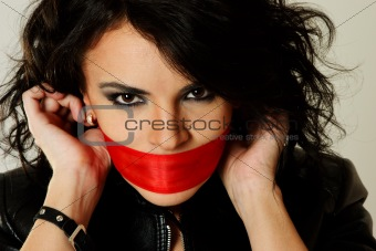 Attractive woman with red ribbon over lips
