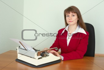 Young girl at office with a typewriter