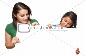 Pretty Hispanic Girl and Mother Holding Blank Board Isolated on a White Background.