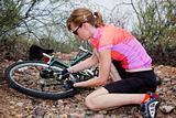 Woman Repairing Mountain Bike